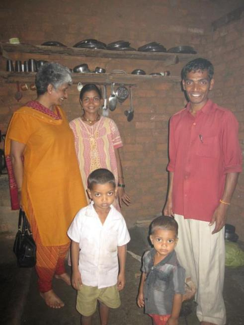 Ms. Geeta Verghese, Coordinator SBI YFI with Shri. Mavanji Pawar and his family at their home in Jawhar, Maharashtra.